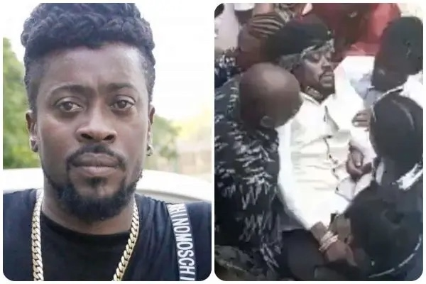 watch:-beenie-man-hospitalized-after-fainting-at-mother's-funeral